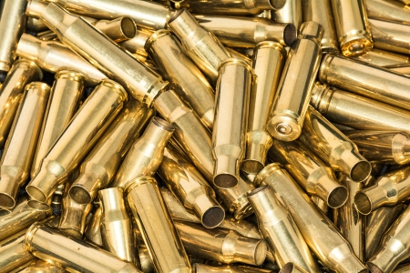 Abstract of pile of empty bullet shells with details