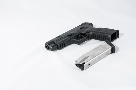 Black hand gun on white background unloaded and safe Stock Photo - 23921495