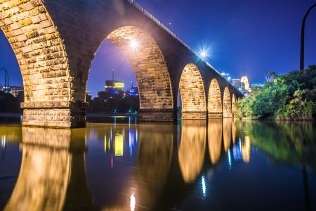 Night scenic view of stone arch bridge with vibrant colors in Minneapolis Stock Photo