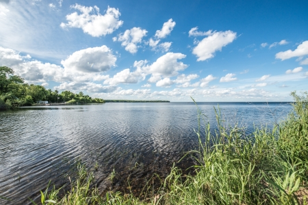 Beautiful landscape of quiet lake and shore during the summer Zdjęcie Seryjne