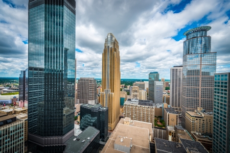 surrounding: Cityscape of downtown Minneapolis Minnesota and surrounding urban during a sunny day
