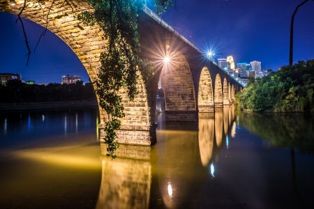 Night scenic view of stone arch bridge with vibrant colors in Minneapolis photo