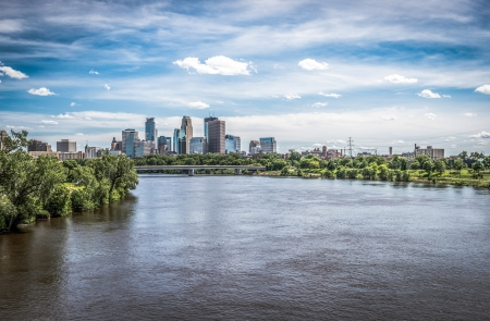 Far view of downtown Minneapolis on Mississippi River photo