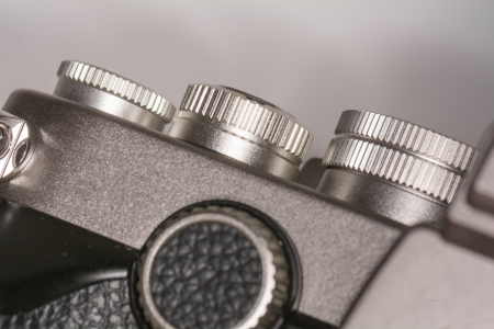 Mechanical dials on top of a old style single lens reflex camera Stock Photo