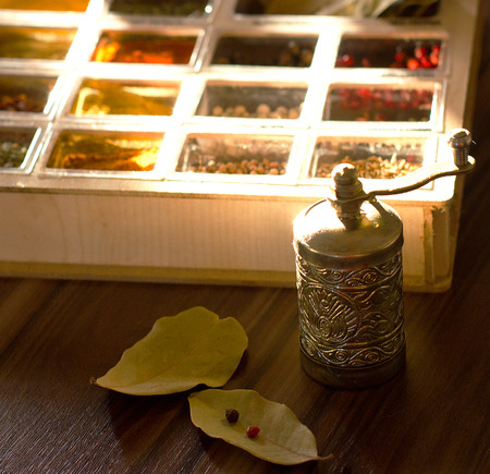 Mix spices in a wooden box with a mill Stok Fotoğraf