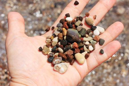 Sea pebble on a hand