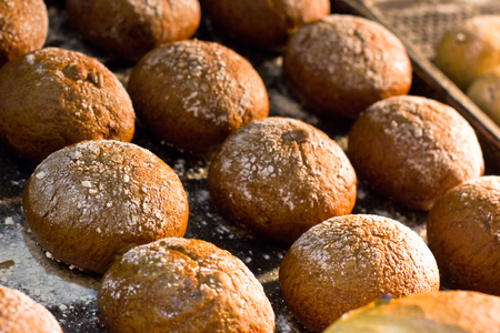 Freshly baked small hot rolls with the raisins. Stock Photo