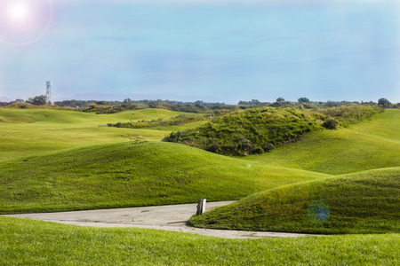 Golf course in Belek. Green grass on a field. Blue sky, sunny day Stock Photo