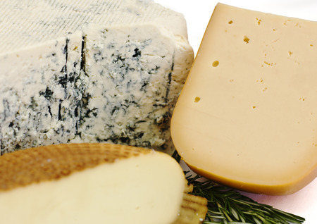 Cheese set. Roquefort with blue mold, cheddar and smoked cheese. Isolated over white background 写真素材
