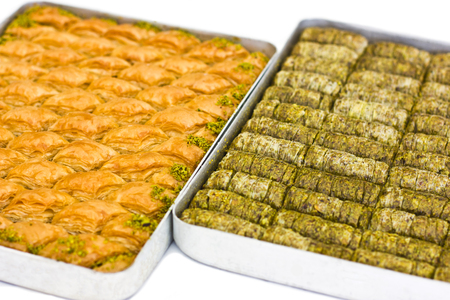 Traditional oriental dessert baklava with pistachios and walnuts. Isolated 免版税图像
