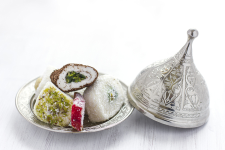 Traditional Turkish sweets lukum on silver saucer with lid