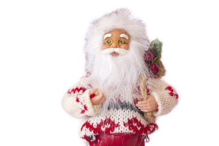 Santa Claus with Christmas gifts. Isolated on the white background Stock Photo