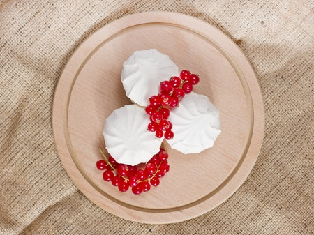 Fresh red currants and the white marshmallows Stock Photo