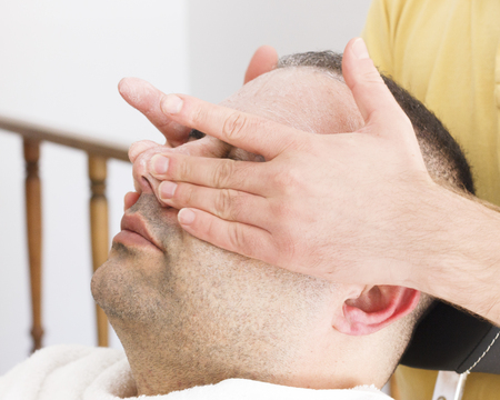 Facial massage for turkish man in barber shop