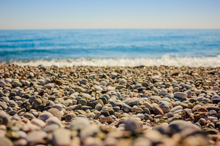 Mediterranean landscape in Antalya, Turkey. Blue sea, waves and pebble beach