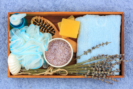 Natural herbal spa cosmetics with a lavender extract - soap, salt, towel, massage brush, washcloth
