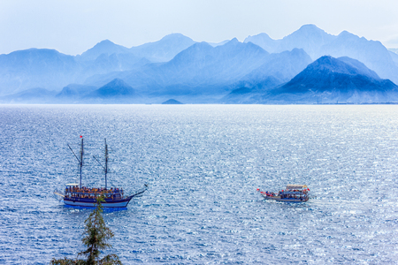 Mediterranean landscape in Antalya. View of the mountains, sea, yachts and city