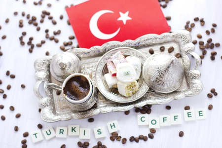 Traditional Turkish coffee and sweets in a silverware with flag of Turkey. Lettering Turkish coffee