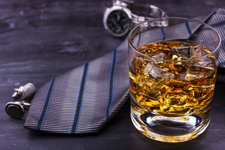 Male concept for father's day. Tie, watches, cufflinks and glass of whiskey with ice 写真素材
