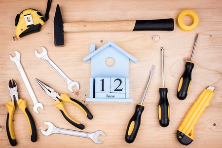 June 12 - Father's Day. Male concept. Repair tools - hammer, screwdrivers, adjustable wrenches, pliers. Sheet of a white paper.