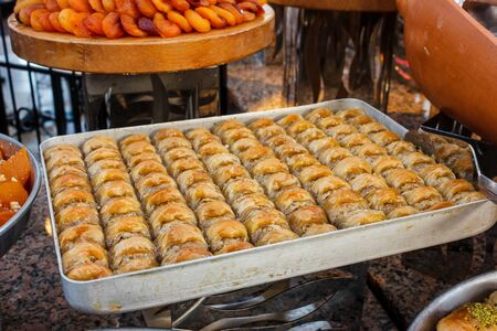Traditional Turkish sweets baklava at the open buffet in a hotel in Turkey