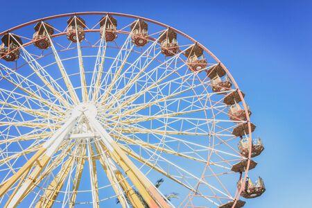 Ferris wheel in an amusement park at the summer