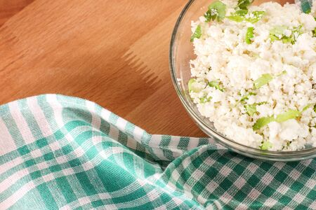 Cottage cheese with a chopped parsley. Diet food