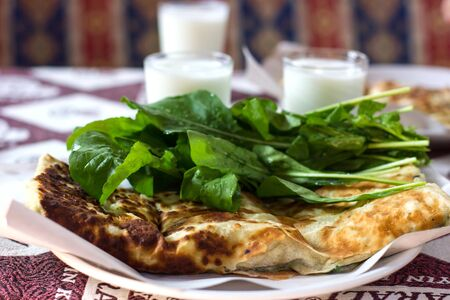 Traditional turkish gozleme tortilla, homemade ayran and arugula
