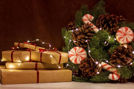 Gift boxes and Christmas wreath with luminous garland. Zdjęcie Seryjne