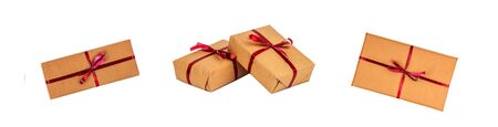 Gift Boxes in Kraft Wrapping Paper with the Red Ribbons isolated Zdjęcie Seryjne