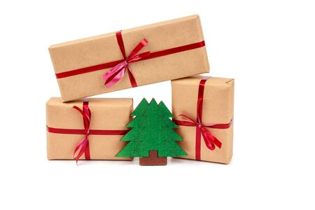 Gift Boxes in Craft Wrapping Paper with the Red Ribbons isolated