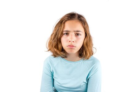 Sad teenager girl isolated. Pretty curly young girl with the big eye looking to camera