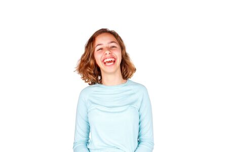Beautiful young girl with a curly hair crazy laughs with open mouth. Happy teenager, isolated