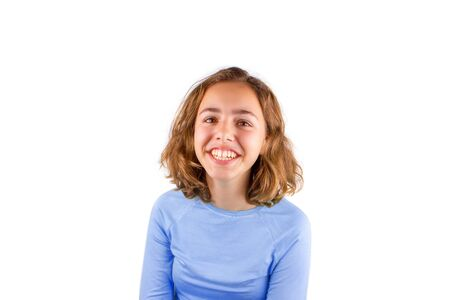 Pretty cute laughing teenager girl in a classic blue t-shirt, isolated