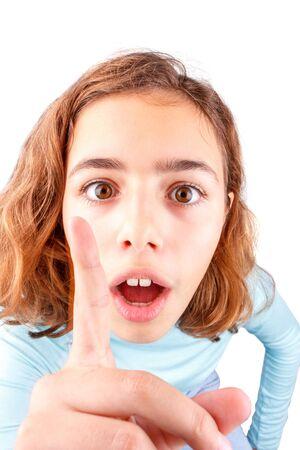 Teen girl tells something by raising her index finger