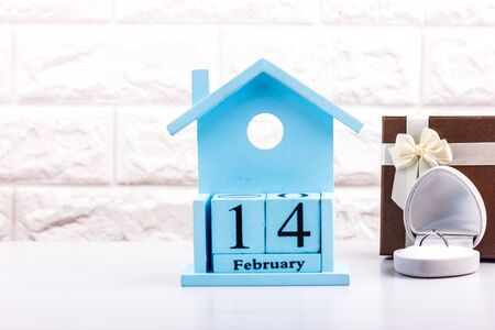 Valentines Day February 14 on the cubes of calendar. Gift Box and Diamond Ring