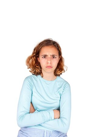 Angry teenager. Beautiful young girl with curly hair angrily looks at camera