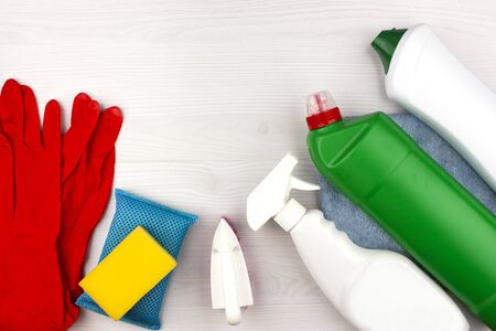 Cleaning tools. Set of cleaning supplies - Spray and cleaning agent, gloves, brush and sponge.