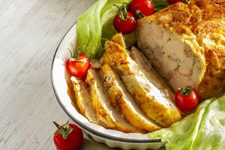 Homemade chicken ham. Oven baked chicken roll