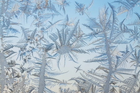 crystallization: The abstract frosty pattern on glass