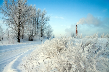 beautiful winter day and industrial air pollution photo