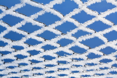 abstract winter background from a lattice against the blue sky photo