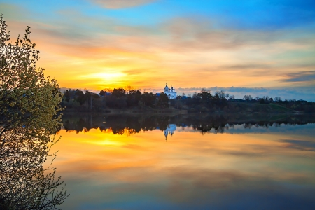 beautiful spring landscape with sunrise over water