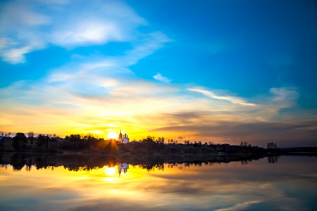 beautiful spring landscape with sunrise over water photo