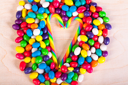 frame  a background from colorful sweets of sugar candies photo