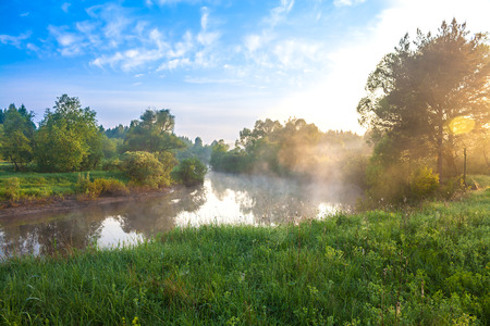 beautiful summer landscape with sunrise over the river photo