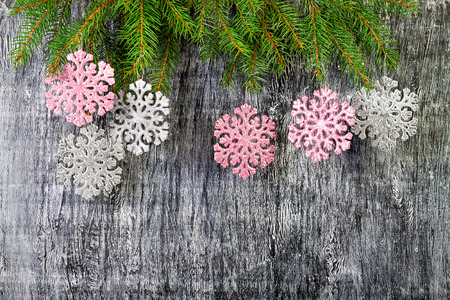 new year background from branches of a fir and snowflakes photo