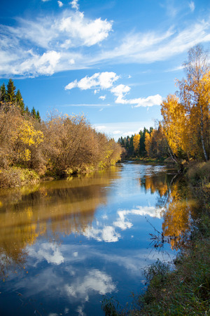 beautiful autumn landscape with the river, the forest and the blue sky photo