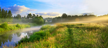 the panorama of a summer landscape with sunrise, fog and the river photo