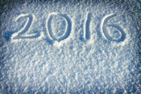 abstract  New Years and Christmas background from snow.text on snow 2016 Stock Photo